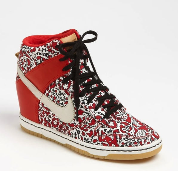 "With this ""hidden"" insole wedge sneaker with a whole lot of printed attitude, we instantly think of NYC cool-girls Azealia Banks and Vashtie when we see this sneaker. Nike Dunk Sky Hi Liberty Wedge Sneaker ($130)"