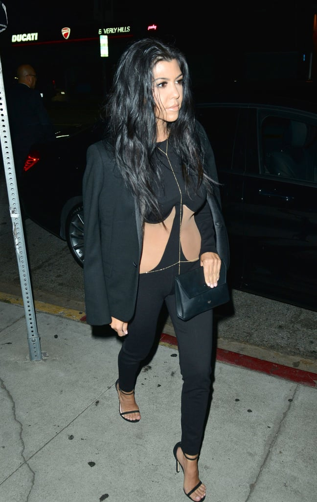 Kourtney Played Up Her Sexy Black Jumpsuit With a Gold Body Chain and Tuxedo Jacket