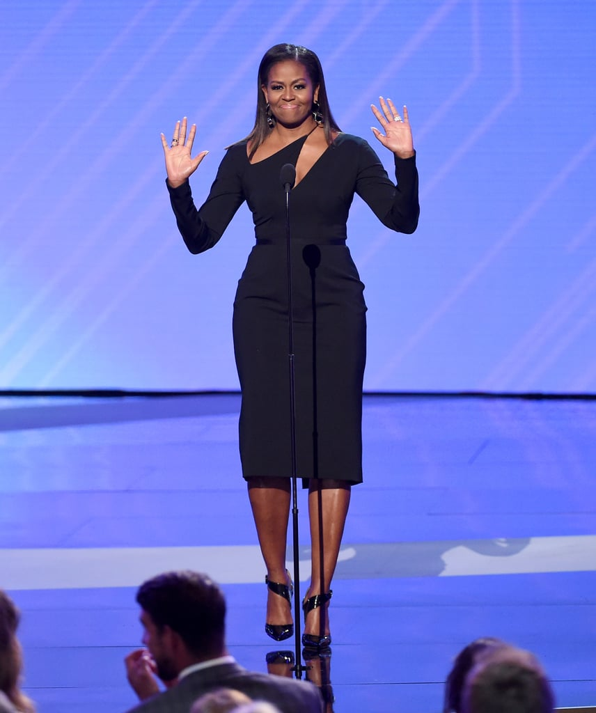 "Michelle Obama may not be in the White House anymore, but she's still making a difference in the community. On Wednesday, the former FLOTUS took a break from her relaxing family vacations to attend the ESPY Awards in LA. After receiving a standing ovation from the crowd, she gave a heartfelt speech as she honored the late Eunice Kennedy Shriver with the Arthur Ashe award for courage. ""I am here tonight to honor a remarkable woman,"" she said about the Special Olympics founder. ""A woman who believed everyone has something to contribute and everyone deserves to push themselves to find out what they're made of and to compete and win. She knew that when we give others a chance to fulfill our greatest potential, we all win."" Eunice's son Tim, who accepted the award on his mother's behalf, took the words right out of our mouths as he started his speech by saying, ""Once a great first lady, still a great first lady.""      Related:                                                                                                           44 Photos of Barack and Michelle Obama's Cutest Moments as America's Former First Couple"