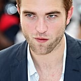 Robert Pattinson posed at the Cosmopolis photocall in Cannes.