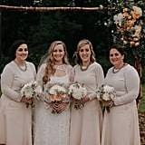 These three bridesmaids wore long-sleeve beige gowns that complimented the bride's lace dress.