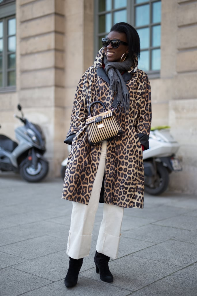 A Leopard print Coat, White Trousers, and Black Boots