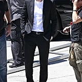 Robert Pattinson wore a suit and sunglasses on set.