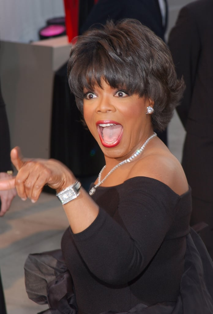 Oprah flashed a smile and a finger at the 2002 Vanity Fair Oscar party.