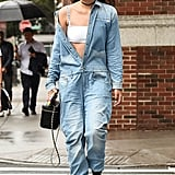 Wear a denim jumpsuit unbuttoned for a cool, casual Summer look.
