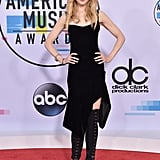 Nicole wearing an Olivier Theyskens dress with Giuseppe Zanotti boots, Fred Leighton jewels, and an Omega watch at the 2017 AMAs.