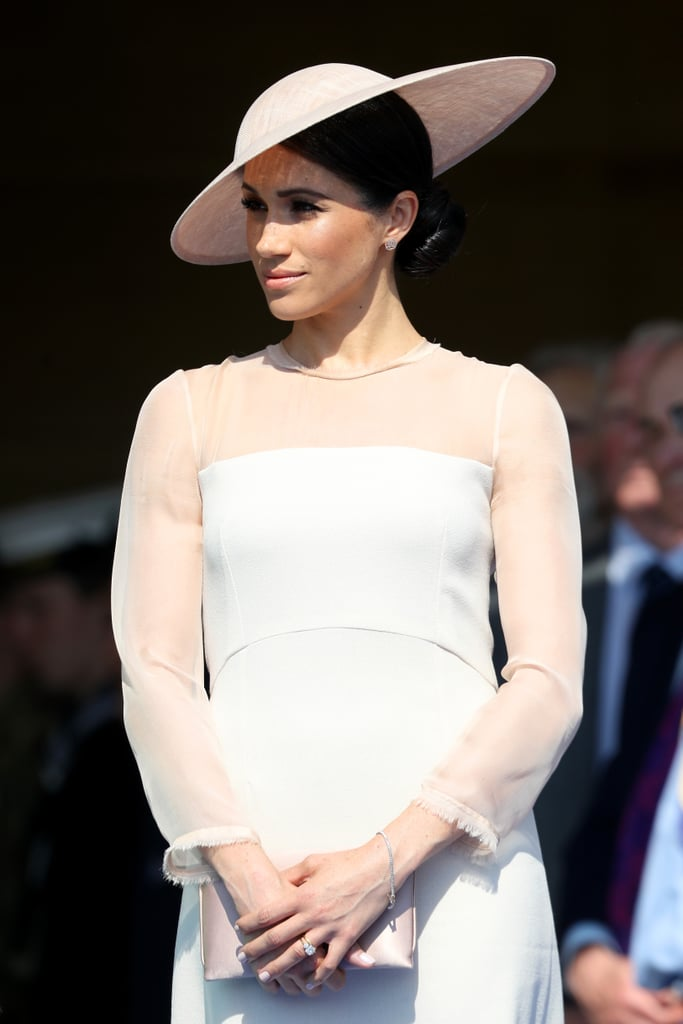 Meghan looked elegant as ever in a similar, looser style at the Prince of Wales's 70th birthday celebration a year before, where she wore a peachy-pink Goat dress featuring sheer sleeves with raw edges.