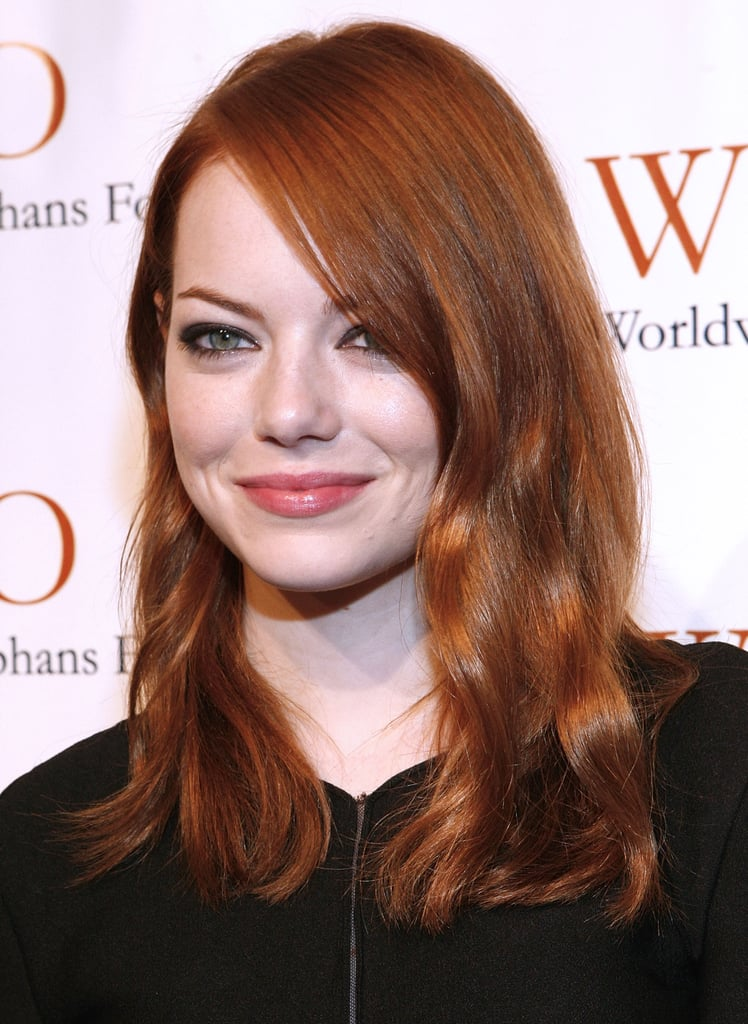 Emma Stone glammed it up for a philanthropic night out.