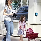 Katie Holmes carried a stuffed panda while Suri Cruise had her hands full with a toy stroller.