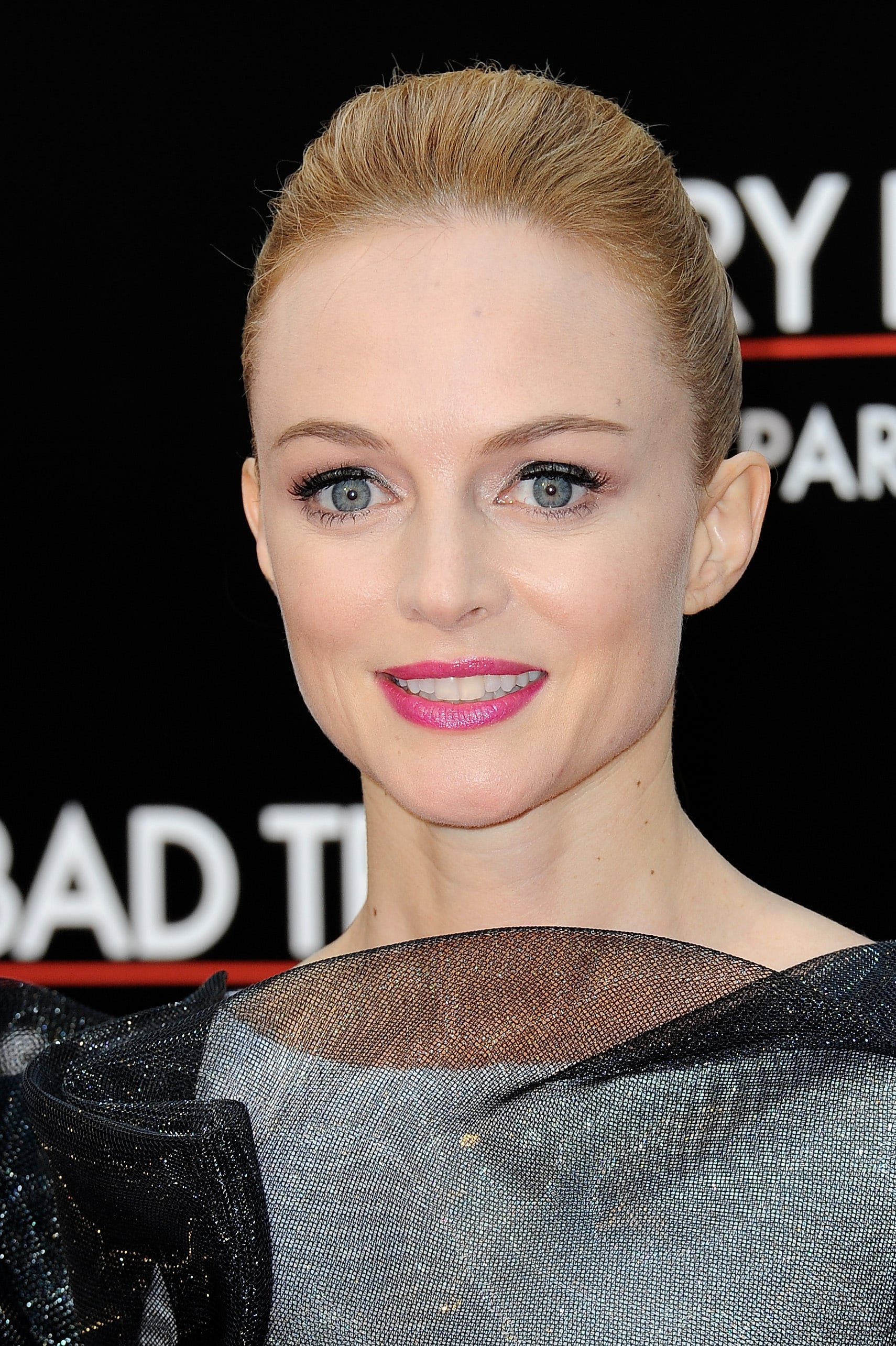 Heather Graham was seen in Paris for the French premiere of The Hangover Part III. She glammed up the red carpet with her slicked-back ponytail, voluminous lashes, and bright pink lips.