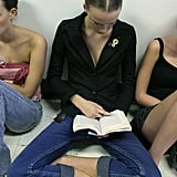 At Benjamin Cho's Spring 2005 show, a model read cross-legged.