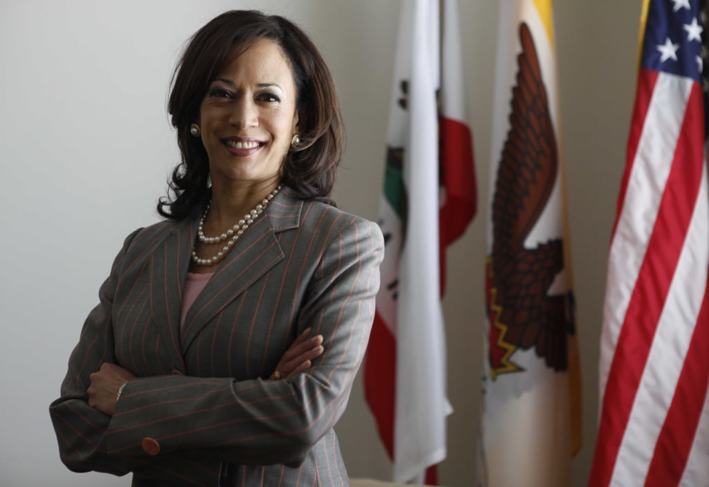 Kamala stood for a portrait as District Attorney for San Francisco in April 2009, coordinating gold-rimmed pearl stud earrings with a double strand of pearls and a fresh pink pinstripe blazer.