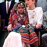 She let a local girl sit on her lap during her visit to Lallapet High School in Hyderabad, India, in February 1992.