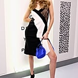 Gigi posed in her dress, which was accessorized with a bright blue bucket bag and black ankle booties.