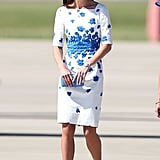 For her stop in Brisbane, Kate chose a white elbow-length L.K. Bennett dress with a smattering of blue blooms at the waist. Gone were her trusty nude shoes, though: instead, she picked a navy pair and carried a bright blue clutch.