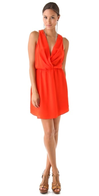 Treat your cocktail attire with the same anti-humidity approach. This orange-hued sheath is draped so that it's just airy enough, but the silhouette is sleek, sexy, and totally evening appropriate.