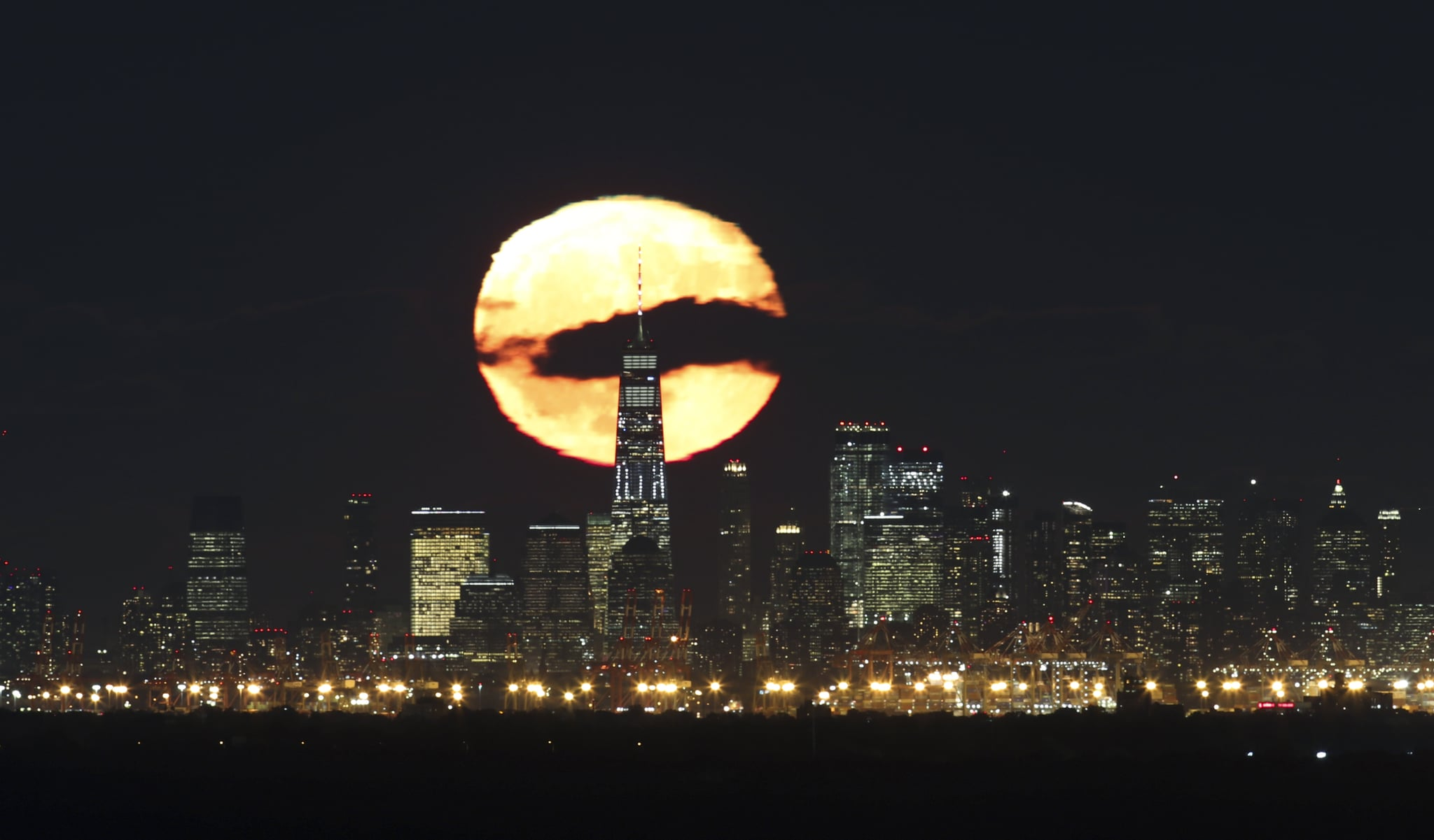 GREEN BROOK TOWNSHIP, NJ - OCTOBER 25: One day after the full Hunter's Moon, the moon rises behind lower Manhattan and One World Trade Centre in New York City on October 25, 2018, as seen from Green Brook Township, New Jersey. (Photo by Gary Hershorn/Getty Images)