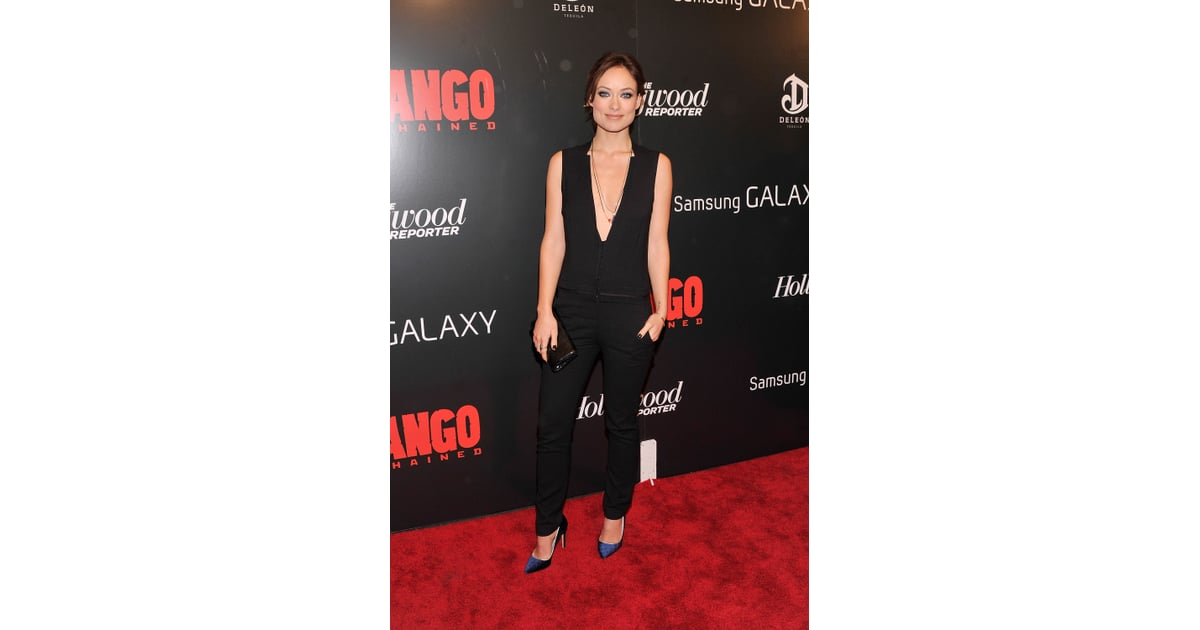 Olivia Wilde stunned in a deep V-neck black jumpsuit and velvet pumps.  559468f7b