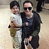 """Literally the cutest little thing I've ever seen. Getting off a flight and being greeted by this tiny Rey was the ultimate!!!!!!!! I will never get tired of seeing this! It's cringey I'm wearing sunglasses but having photographers taking pictures after a 10 hour flight is blinding (this picture was taken by the lovely girl's mum!) #starwars #theforceawakens #REY!"""