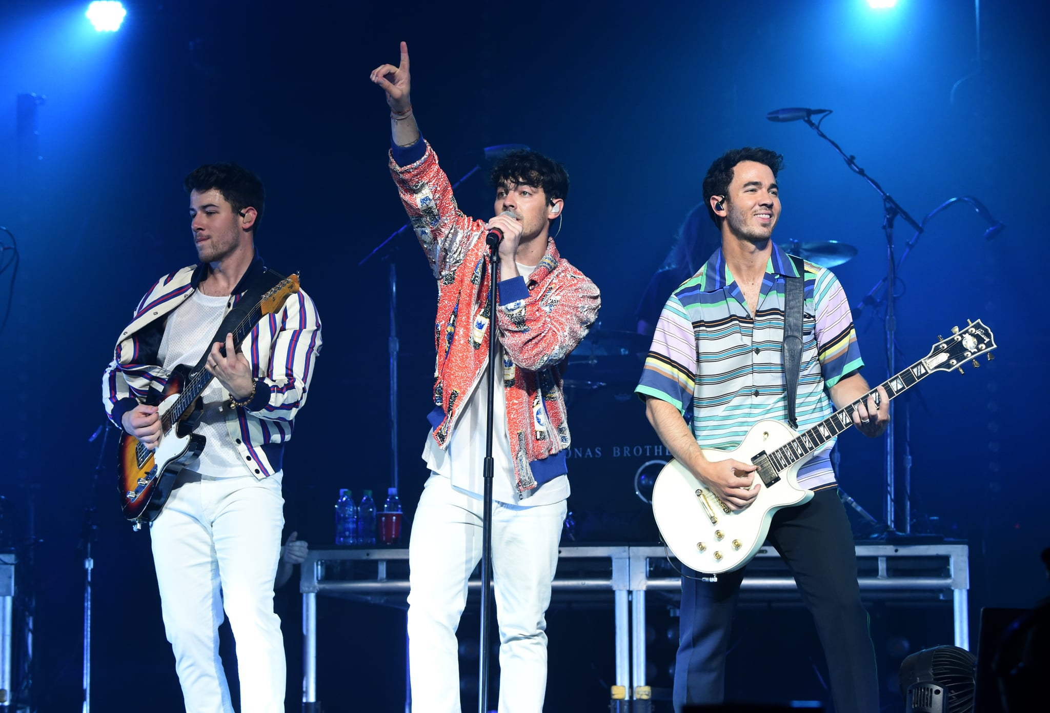 MINNEAPOLIS, MINNESOTA - APRIL 06: (L-R) Nick Jonas, Joe Jonas, and Kevin Jonas of the Jonas Brothers perform onstage at the March Madness Music Series featuring Jonas Brothers presented by Coca-Cola during the NCAA March Madness Music Series at The Armory on April 06, 2019 in Minneapolis, Minnesota. (Photo by Kevin Mazur/Getty Images for Turner Sports)