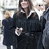 Emmanuelle Alt dressed up a white button-down with a fringed jacket.