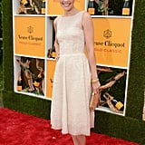 Leslie Bibb chose an ivory-hued frock for the occasion and partnered it with a gold clutch and ankle-strap sandals.