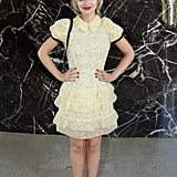 Imogen Poots was adorably demure in yellow at the Miu Miu runway show.