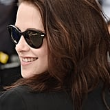Kristen Stewart wore sunglasses to the On the Road photocall at the Cannes Film Festival.