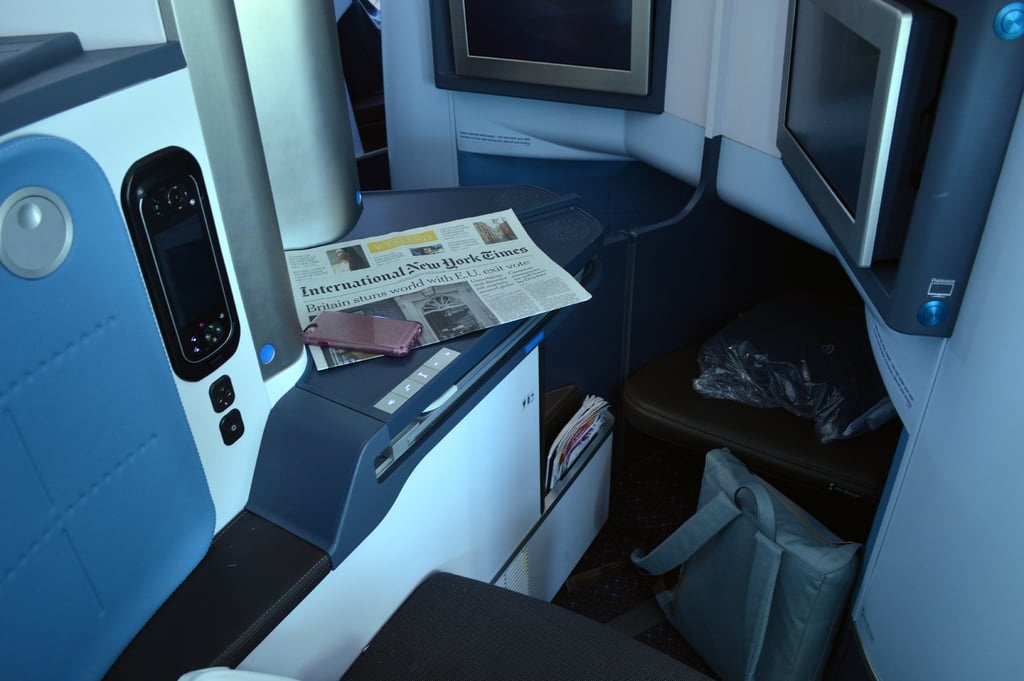 My seat was one in the center of the aisle so I didn't have a window view nor the entire nook to myself. However, the seat offers you such privacy that you don't really ever interact with the person next to you. When you first arrive, the seat has a compartment full of magazines and newspapers, a blanket, and pillow. The silver compartment opens up to a small space to store glasses or touch up your makeup.
