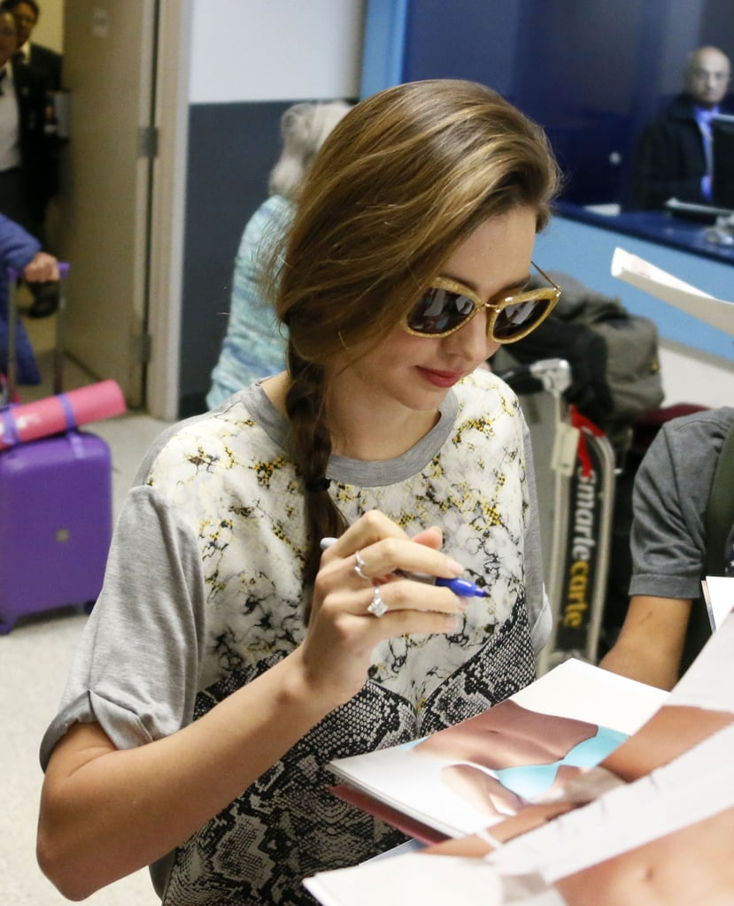 Miranda signed autographs when she landed.