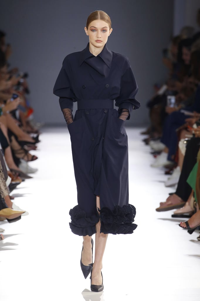 Gigi Leading the Pack in a Black Ruffled Trench at Max Mara