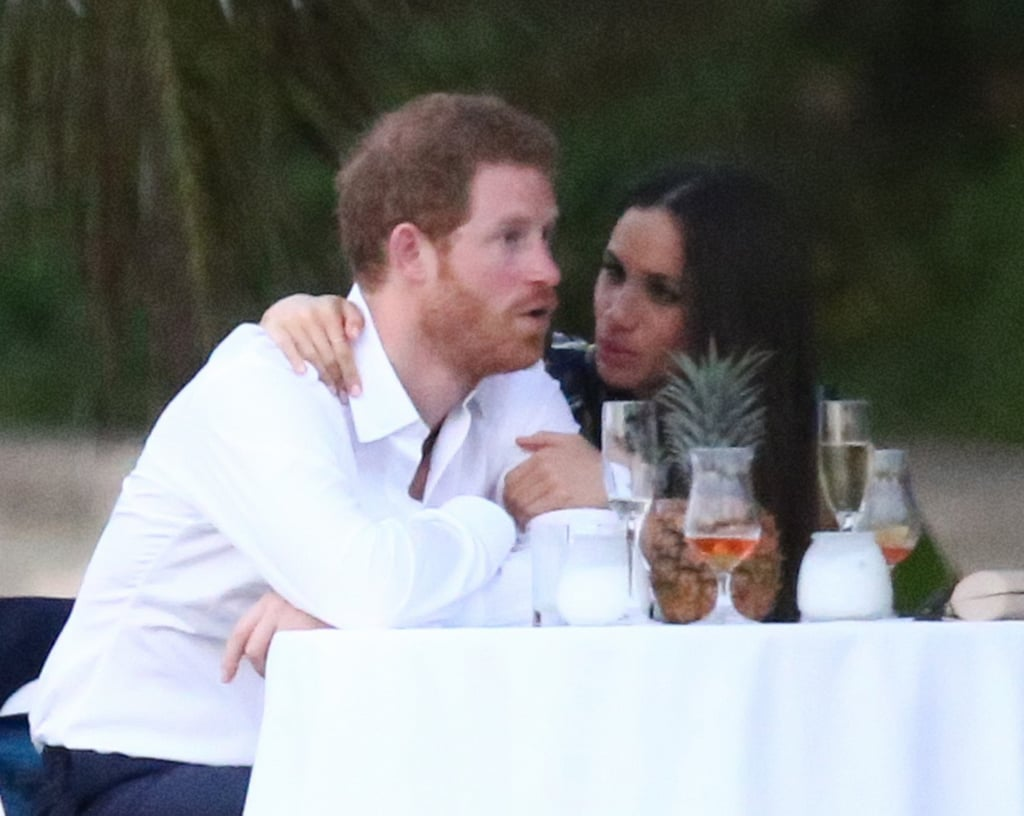 "Prince Harry and Meghan Markle took another big step in their relationship on Friday — he brought her as his date to his best friend's wedding in Montego Bay, Jamaica. The two met up in the Caribbean to watch Harry's childhood friend, Tom ""Skippy"" Inskip — who was popularly known as Harry's ""wingman"" — tie the knot with literary agent Lara Hughes-Young. They seemed to be enjoying each other's company as they laughed and sipped champagne and beer at their table. The Suits actress stunned in a floral maxi dress, while Harry looked dapper in a white shirt and dark slacks. ""Meghan was laughing and put her arm around Harry's back as she spoke,"" an insider told Us Weekly. ""People were coming up to Harry and he got up and hugged and kissed each one on the cheek. Each time someone came up to Harry, Meghan stood up at the table to greet the friend as well. She was holding Harry's hand or rubbing his back as he spoke to his friends and she seemed comfortable."" At one point, Harry even ""busted out with some dance moves"" and ""Meghan looked on adoringly at him. He wasn't shy at all about dancing and just stood next to the table snapping his fingers and dancing for her."" The special occasion was also regarded as a coming out for the new couple, as it is thought to be the first time Meghan has accompanied the prince to a wedding. Sounds like things are getting serious!"