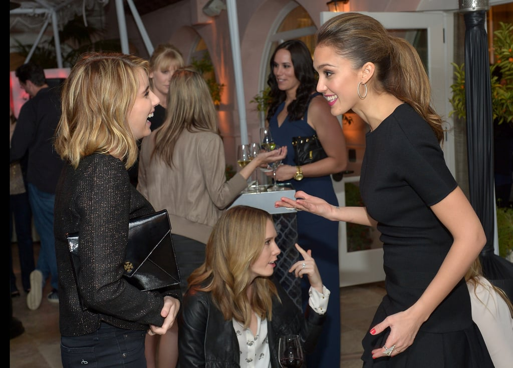 Jessica Alba had a laugh with Emma Roberts while socializing at the Condé Nast Traveler Hot List Party in LA.