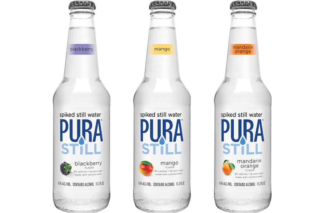 """If you often get bored at the thought of spending your day gulping down bottles of flavorless water, boy do I have news for you. Thanks to the genius minds over at Pura Still, spiked still water is officially a thing, so if you need me, I'll be out buying a six-pack.  Pura Still is a flavored, alcoholic still water that the company describes as being the """"first of its kind"""" since it """"doesn't need bubbles to keep things interesting."""" According to a product description, its primary ingredients are purified water, malt alcohol base, cane sugar, citric acid, natural fruit flavors, and coconut water powder. The gluten-free water is sold in three different flavors (blackberry, mango, and mandarin orange) and each bottle contains 90 calories and 1 gram of sugar, coming in at 4.5 percent ABV — just enough to get you a little tipsy, depending on your level of tolerance. Pura Still is currently sold in stores like Trader Joe's, Rite Aid, Walmart, and more, so you can check out the store-locating tool on the brand's official website to find out where to buy it near you. Before you throw on your shoes to make a grocery store run, keep reading to get a look at each flavor.      Related:                                                                                                           Drinking Water Just Got More Fun — Here's How"""