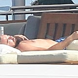 On Tuesday, Leo soaked up the sun shirtless.