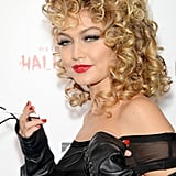 She swiped on a bright red lip and showed off a full head of curly locks, just like Sandy in Grease!