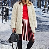 On Editor Sarah Wasilak: Karen Millen top and dress, Fendi bag, BaubleBar earrings, Rebecca Minkoff shoes, and coat and tights editor's own