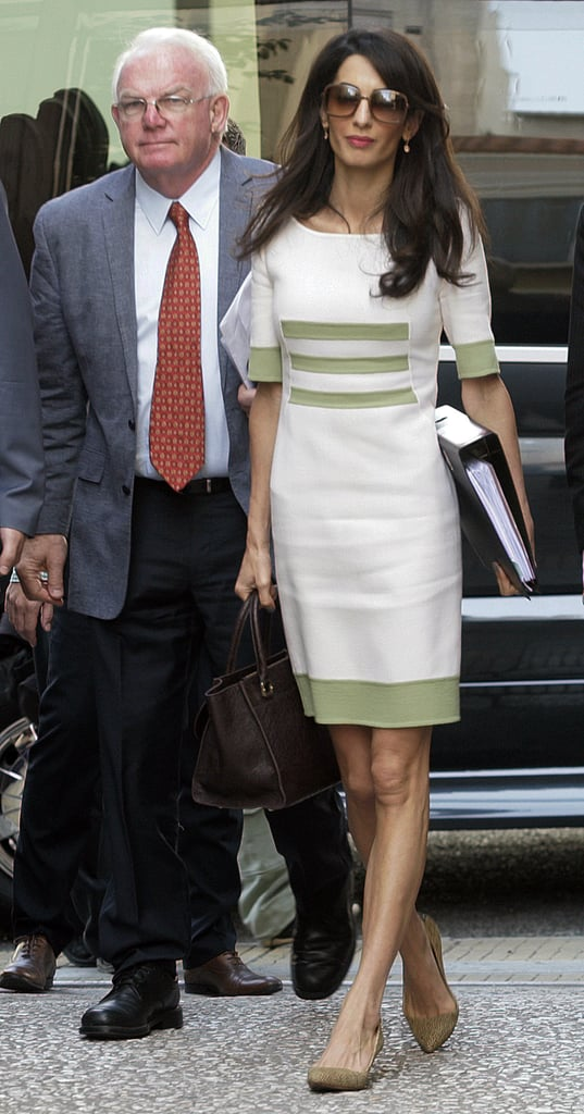 Amal's cream sheath dress by Camillo Bona Haute Couture felt appropriate but a little unexpected, too.