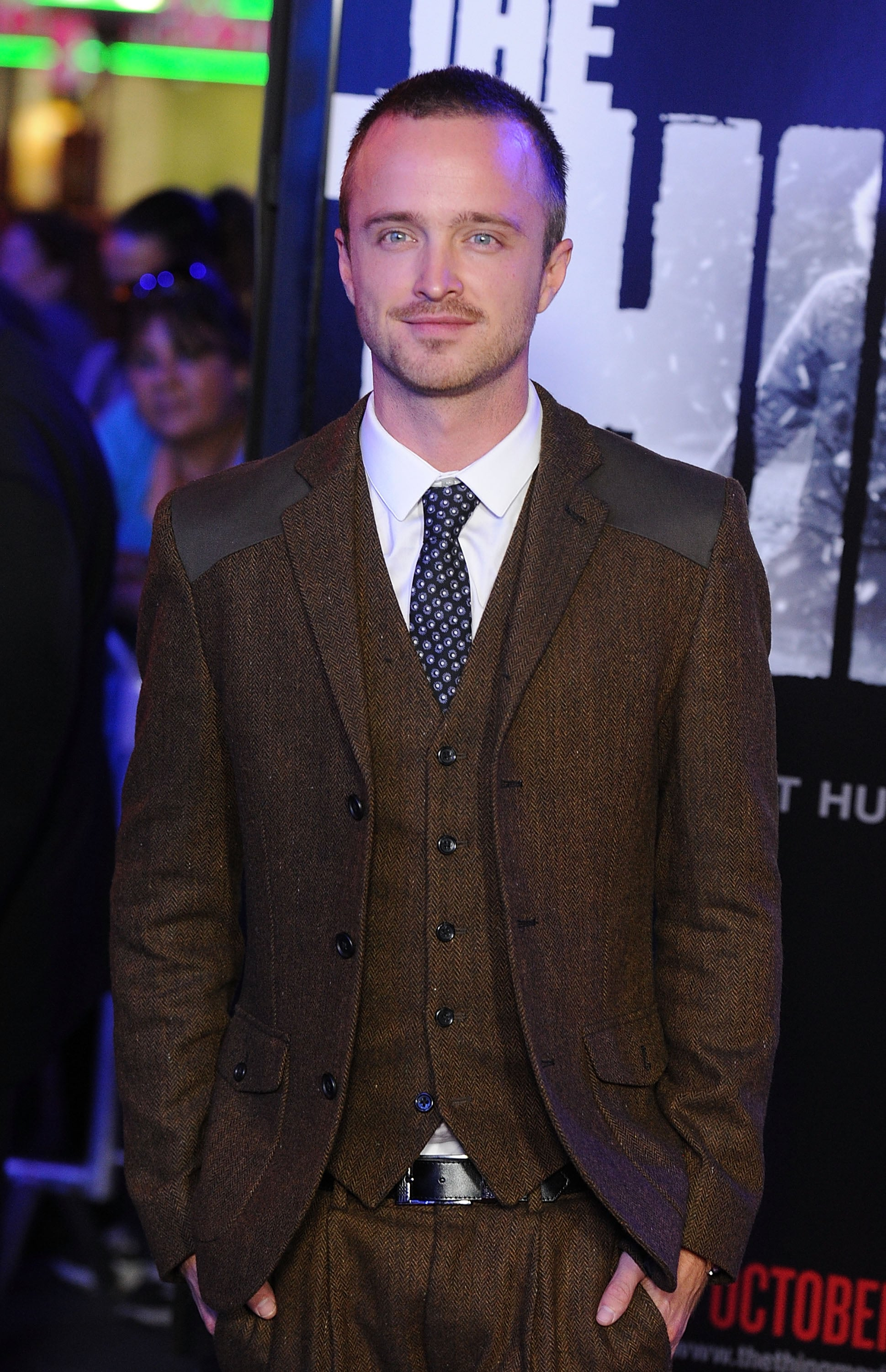 Aaron Paul wore a brown suit at the LA premiere of The Thing.