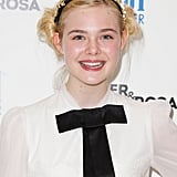 Elle Fanning pulled off a black tie.