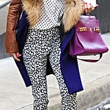 Olivia smartly paired her Banana Republic trousers with a traffic-stopping Delvaux satchel.