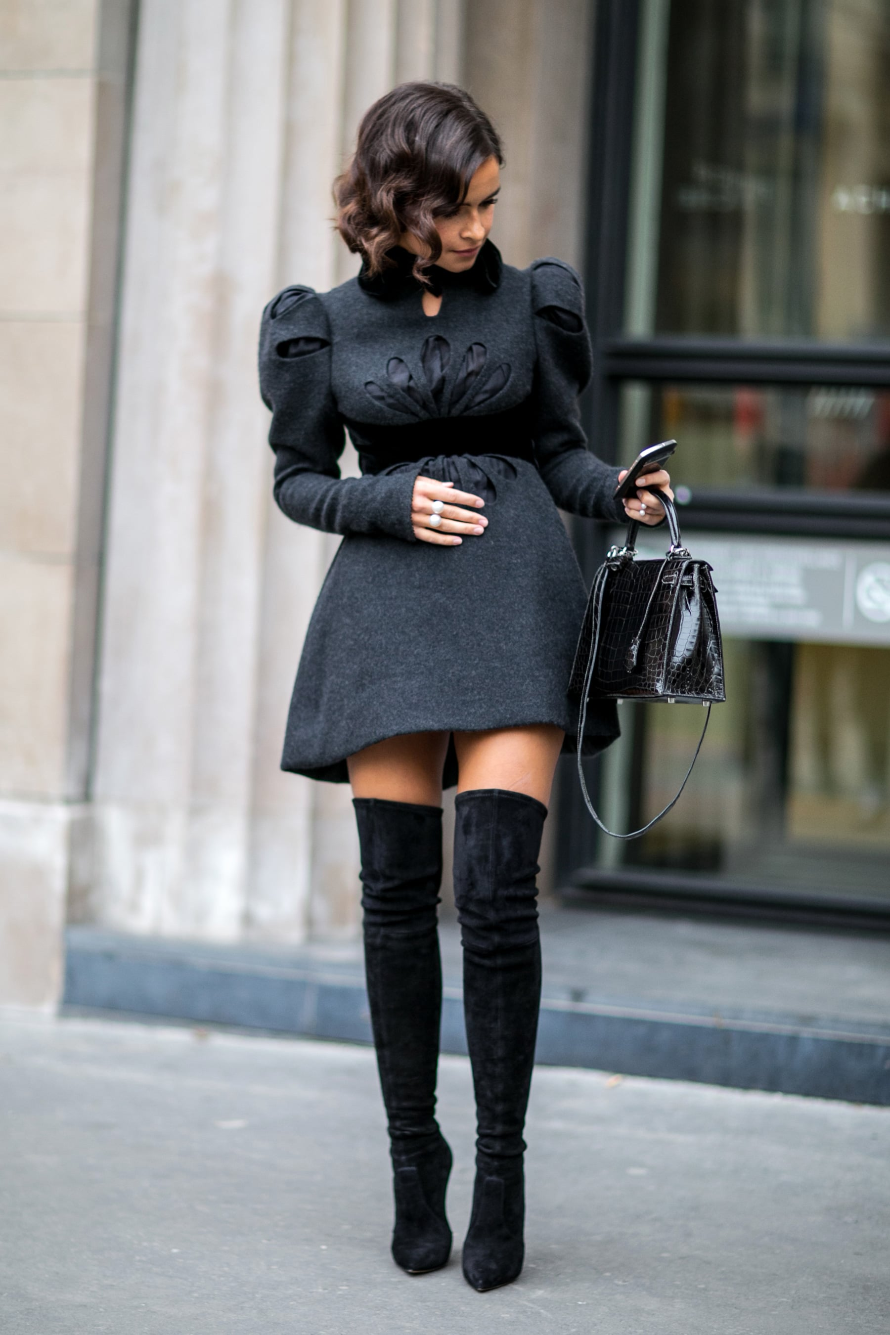 Miroslava Duma knows the trick to making a sweet dress a little sexier is over-the-knee boots.