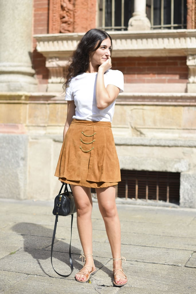 A white tee took the backseat to this '70s-feeling tan skirt — a styling formula you'll want to tuck away for the rest of the season.
