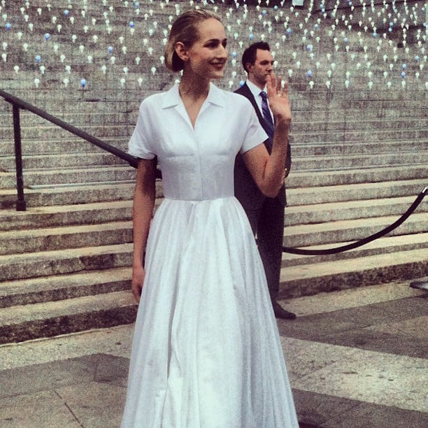 Leelee Sobieski looked superchic in a white, pointed collar Spring '12 Jil Sander dress. We love that she complemented her clean, minimalist ensemble with a fresh face and slicked-back hair.