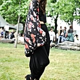 This festivalgoer gave head-to-toe black an unexpected spin by adding a colorful Free People kimono.