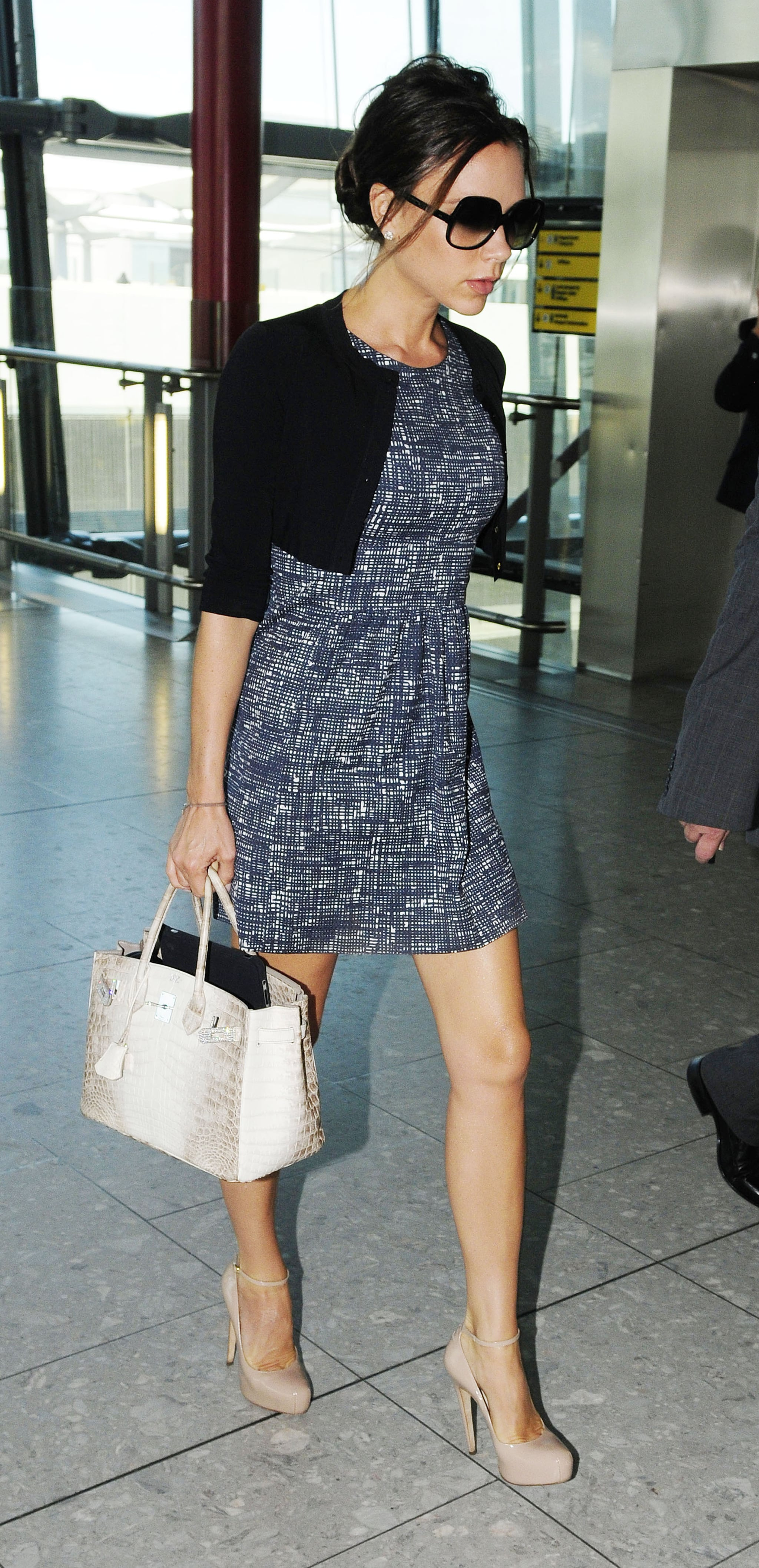 Pictures of Victoria Beckham at Heathrow Airport After