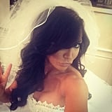 Naya Rivera completed her bride costume with a large, flowing veil.
