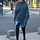 Gigi ran errands around Paris in leggings, booties, an oversize chambray shirt, and a luxe turtleneck sweater for extra warmth. She accessorized with a crossbody bag and her go-to Krewe Du Optic mirrored sunglasses.