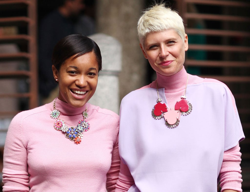 Friends who dress together, stay together. These two gave their pretty pink tops a bit of glitz with their respective statement necklaces. Source: Greg Kessler