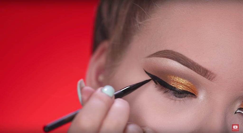 Draw on the liquid eyeliner.